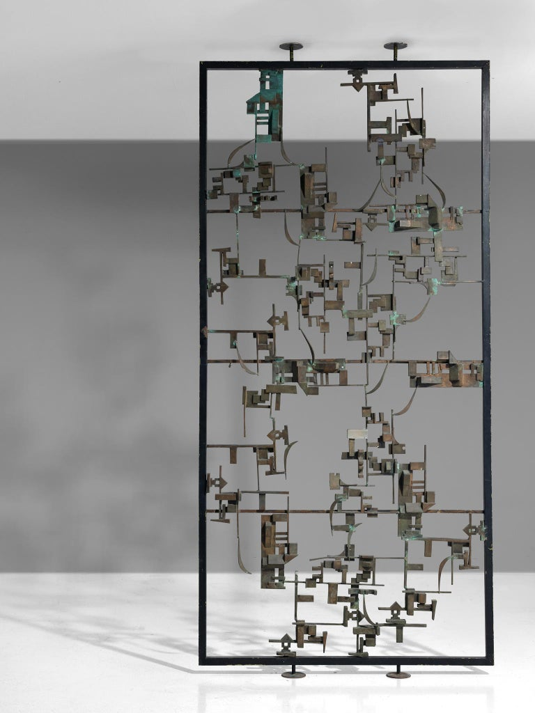 Room divider, bronze and metal, Italy, 1960s  An Italian Postwar room screen that finds itself at the intersection of art and design. This highly sculptural piece consists of an abstract structure in bronzewith abstract shapes and contrast between