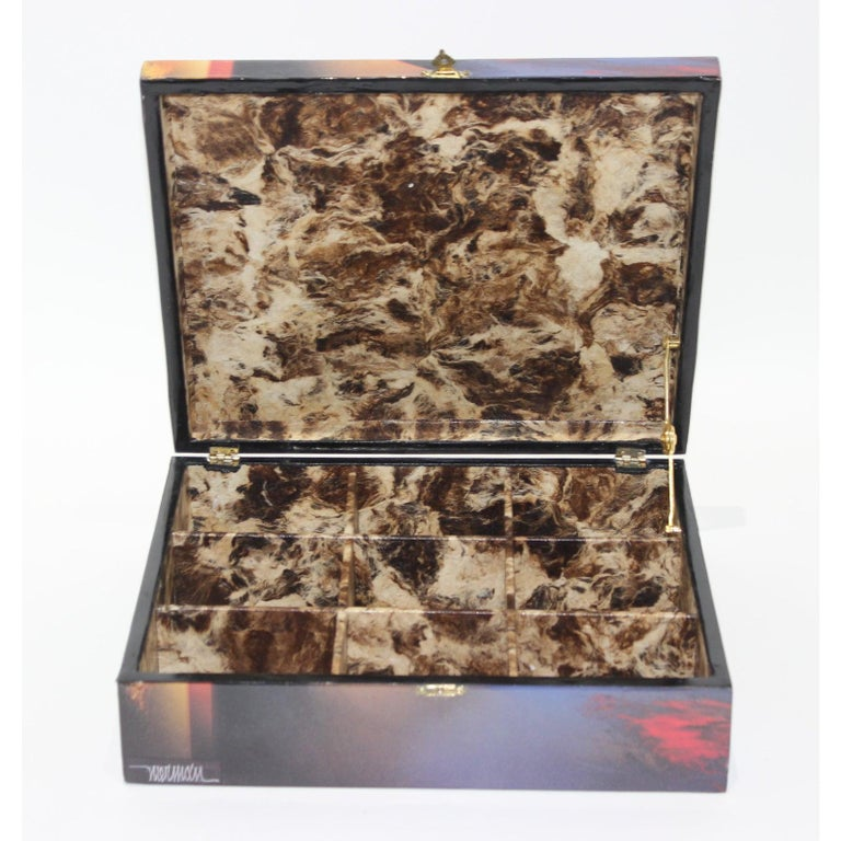This stylish artisan created storage box dates to the 1990s and was created in a limited edition (23/200) and is fabricated in a marbalized paper (on the inside) and printed paper (outside) that has a clear coat of resin. The piece is signed by the