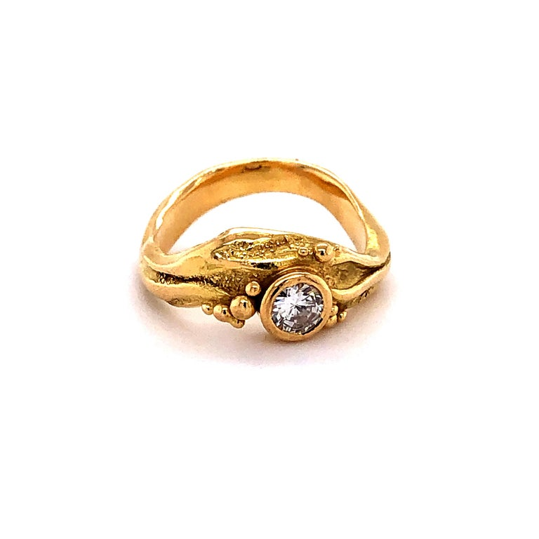 Beautifully crafted yellow gold ring designed by Swiss Jeweler Marc Schnyder. Artisan workmanship, bezel set with one brilliant-cut diamond of 0.35 ct (Quality: G/H-vvs).  btw: we carry the matching earstuds on stock!  Ring Size: 53.5 EU / 6.45