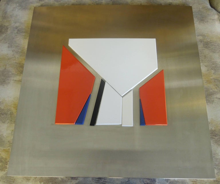 Jean Baier (1932-1999) was a Swiss modernist painter and sculpture. This rare piece from Galerie Ziegler in Geneva, Switzerland, 1971 show. On stainless steel, are ten lacquered wood pieces. White, creme, black, read and navy blue. Numbered 167/300