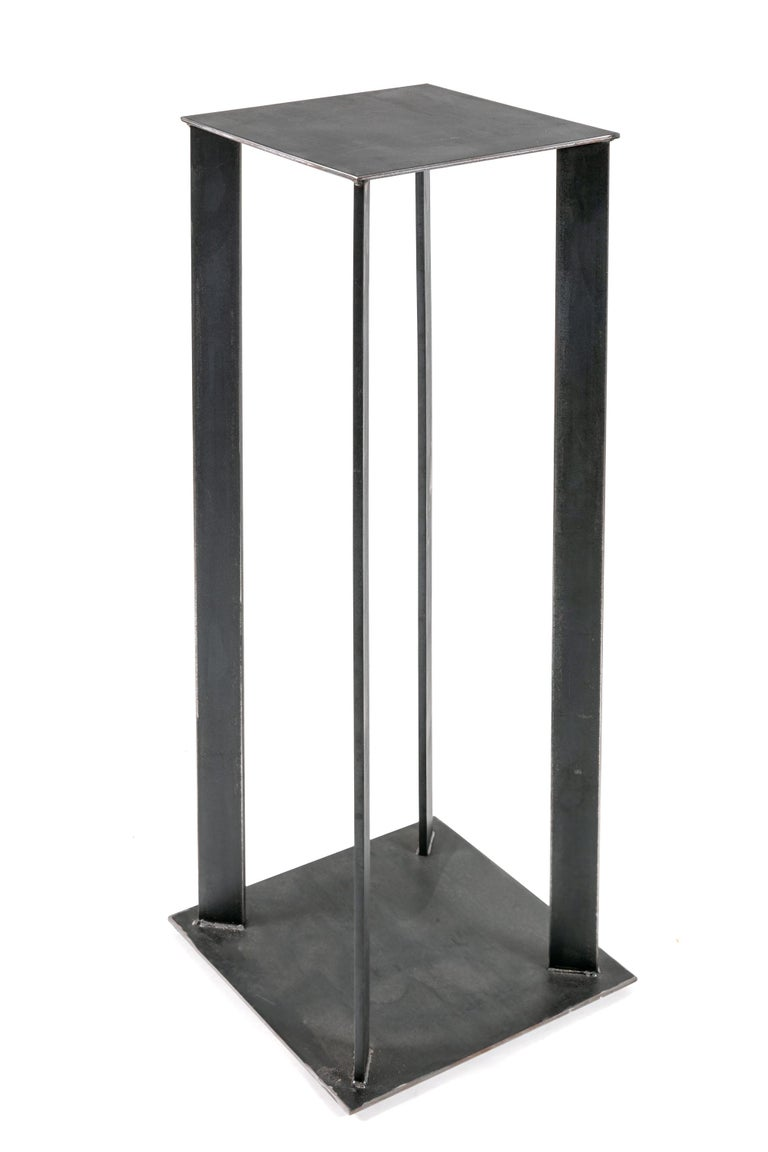 A simple design perfect for displaying art objects by local New York area contemporary sculptor Robert Koch.