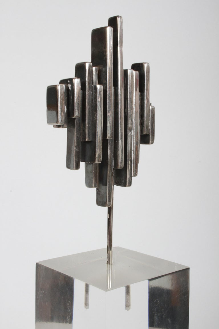 R.W. Smith signed and dated 1971 sterling silver mini abstract sculpture on lucite base. Lucite cube base has one slight blemish to top edge, otherwise nice vintage condition, with light surface scuffs. Lucite base is 4
