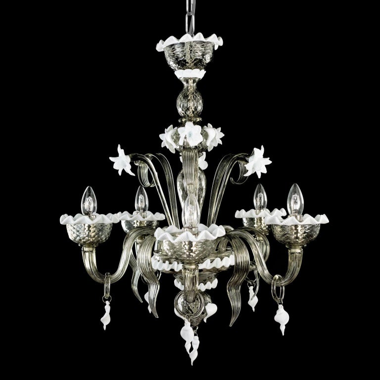 Artistic chandelier 5 arms in dark grey Murano glass and white details Springtime. The peculiar characteristic of this lighting work is the richness of its decorations.  Springtime reflects the authentic Murano glass tradition, which has become