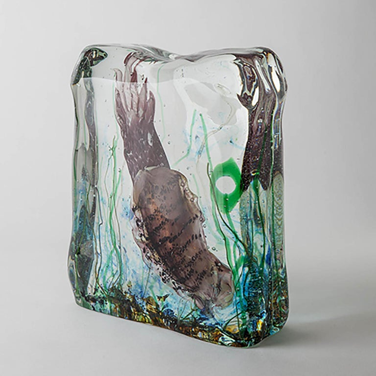 Solid Murano glass acquarium made with the Sommerso techinique.  This technique requires a blown work in thick glass to be immersed in a pot containing transparent glass of a different color and of equal thickness overlaying thick transparent