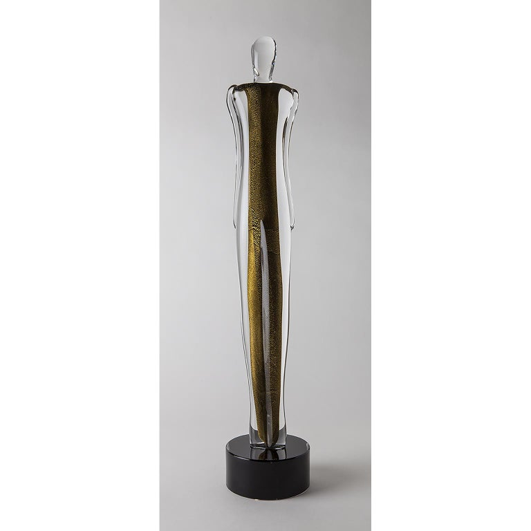 A modern sculpture portraying the soul of a glass man. Core of black glass with 24-karat gold leaf Sommerso with clear glass.