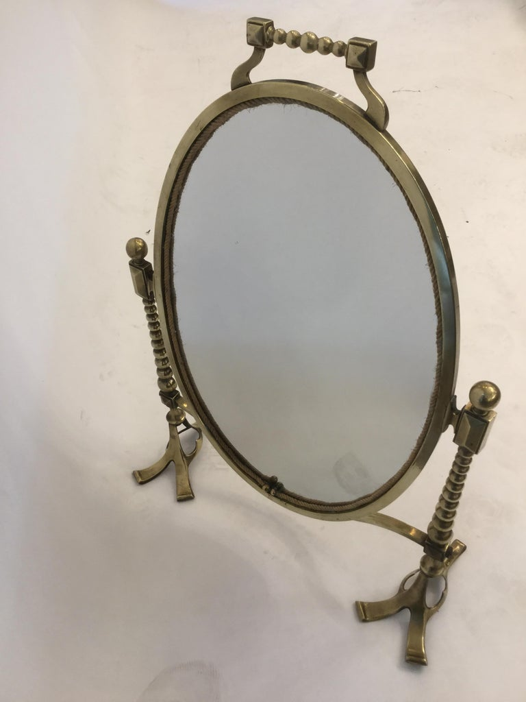 A beautiful vanity mirror in brass, 1900, England.