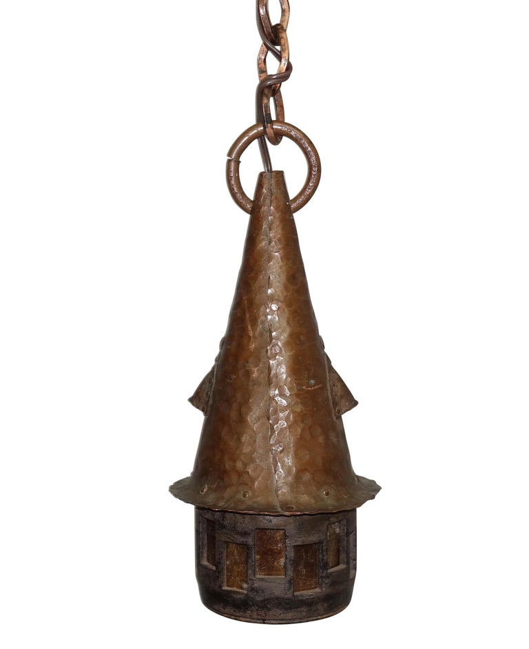 Prairie School style hand-hammered copper lantern with slag glass cutouts, copper chain and canopy. Recently, re-wired, American, circa 1930.