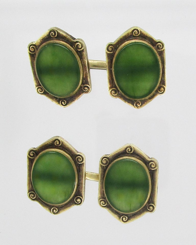 In a magnificent example of the Arts and Crafts design, these cufflinks pair stunning green jade with 14k green gold frames to create the perfect accessory for the distinguished gentleman. The links boast translucent jade panels with a rich green