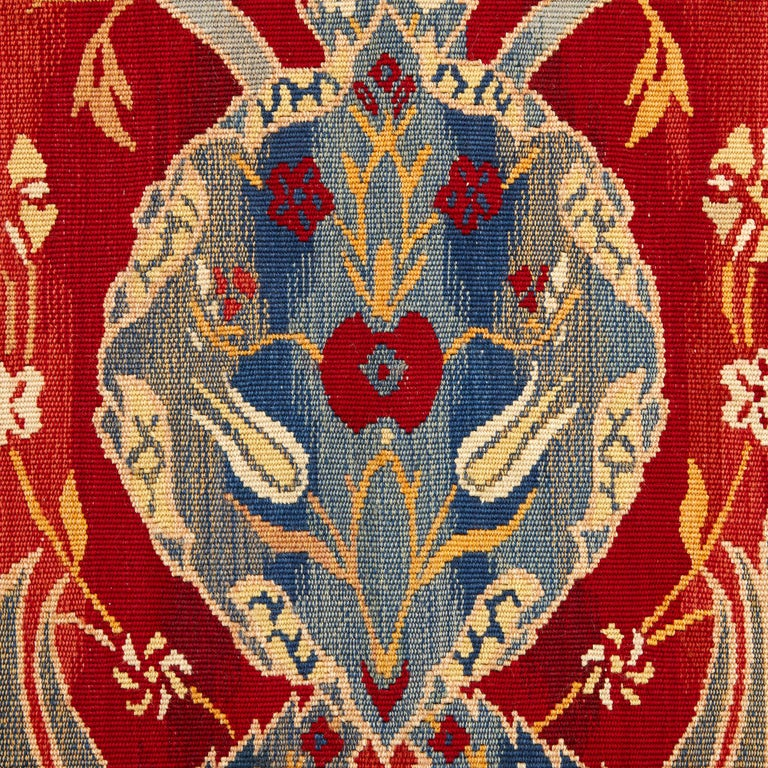 This exquisite textile was created in England in the early 20th century, when the Arts & Crafts style was in fashion in the decorative arts. The movement championed traditional methods of working by hand to create beautiful objects which were then