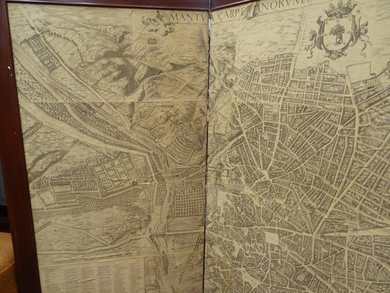 An amazing wooden screen, Arts & Crafts, circa 1900, with an engraving. A Madrid map, from the same epoca. The original engraving was made in 1656 by Pedro Teixeira Portuguese cartographer in the service of King Felipe IV of Spain (Lisboa