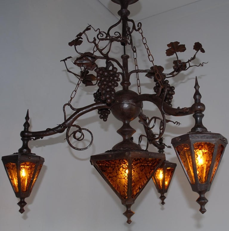 Amazing & marked with a monogram, Arts and Crafts chandelier.  This all-handcrafted work of lighting art is the only one of its kind and in an amazing condition. If you are a collector of top-quality, early 20th century workmanship then this forged