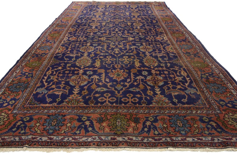 72074, antique Turkish Sparta Gallery rug with traditional Luxe style. Majestic and opulent, this hand knotted wool antique Turkish Sparta gallery rug features an all-over geometric pattern on an ink blue field. It is framed with a complementary