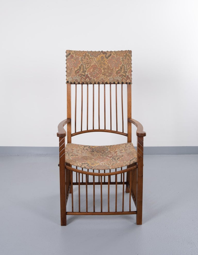 Never have seen another one of this armchair in the Arts & Crafts style. Love the bars on this chair, special on the back. Gobelin upholstery.