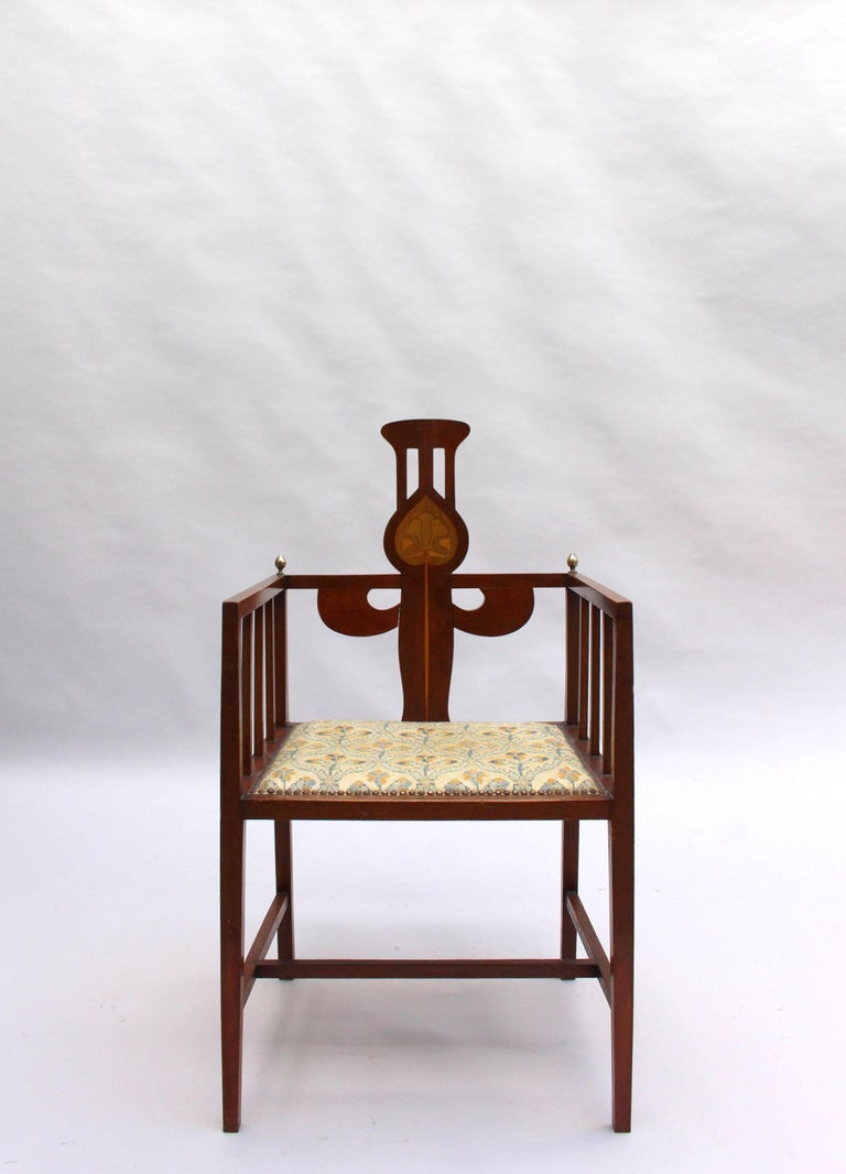 Designed by George Montague Ellwood and made by J S Henry, with marquetry and brass details.