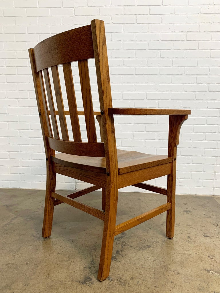 Solid oak Mission style arm / desk chair.