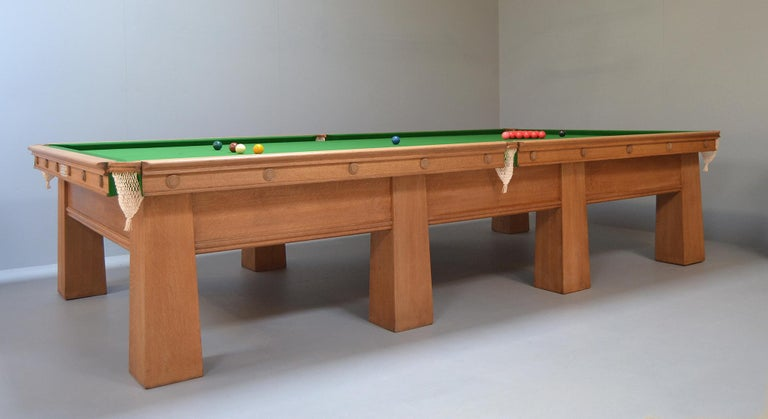 A wonderful Arts & Crafts billiard or snooker table in solid oak by Burroughes & Watts of London, this beautiful table has great presence.