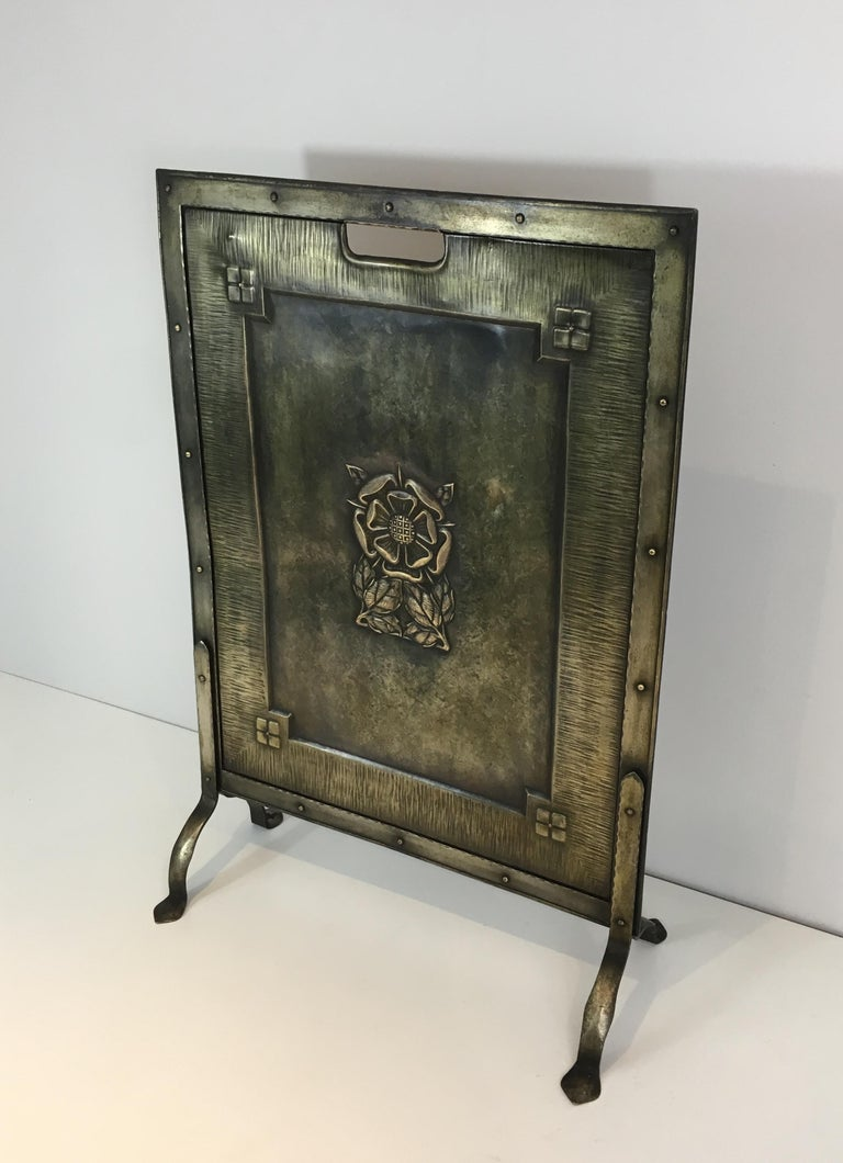 This fire place screen is made of brass and iron. This is an Arts & Crafts work, circa 1900.