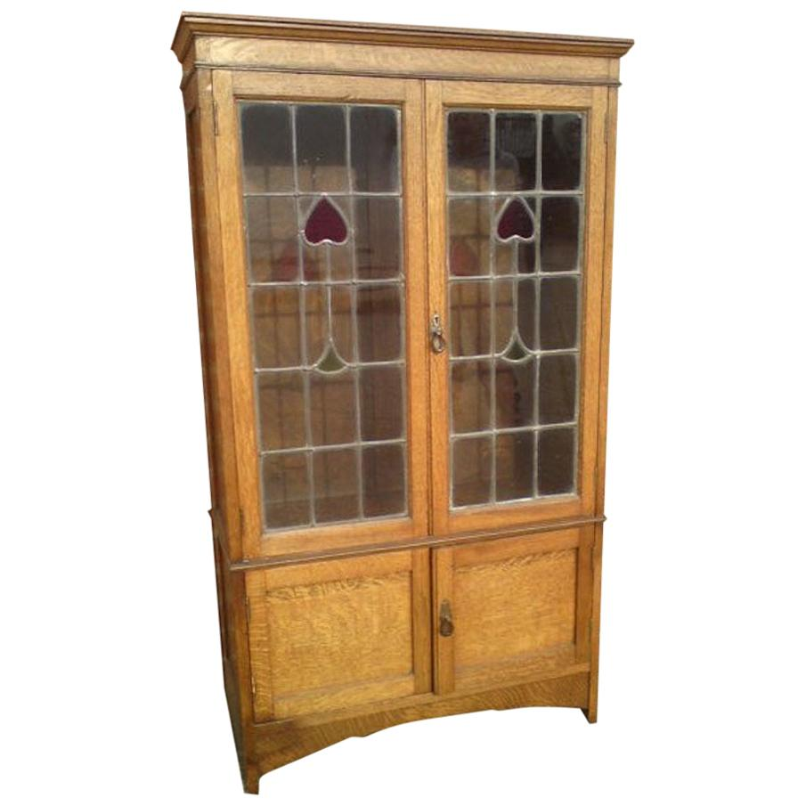 Arts & Crafts Oak Bookcase with Stylized Floral Stain Glass and a Cupboard below