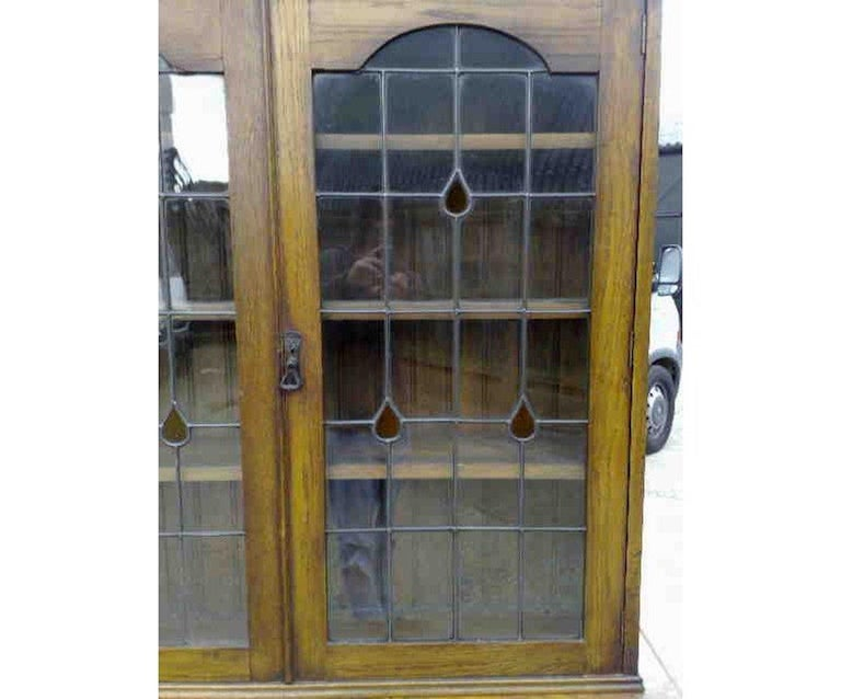 English Arts & Crafts Oak Bookcase with Teardrop Stain Glass, Drawers and Lower Cupboard For Sale