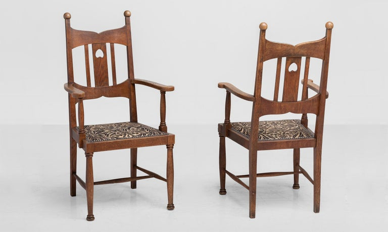 Arts & Crafts oak dining armchairs, England, circa 1900.