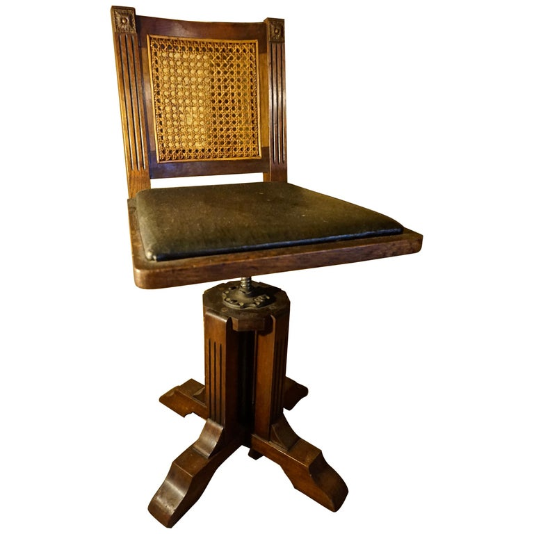 Arts & Crafts Physician's Mahogany Swivel Chair with Original Cane and Leather For Sale