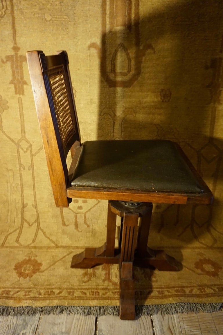 Arts and Crafts Arts & Crafts Physician's Mahogany Swivel Chair with Original Cane and Leather For Sale