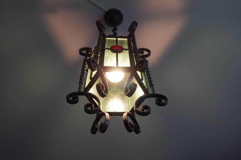 Arts & Crafts Style, Hand Forged Wrought Iron & Cathedral Glass Pendant Light In Good Condition For Sale In Lisse, NL
