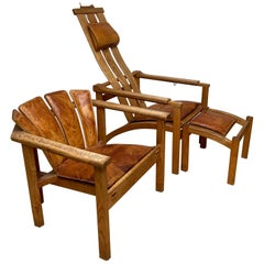 "Arts & Crafts Style Pair of Oak and Leather ""Safari"" Lounge Chairs with Ottoman"