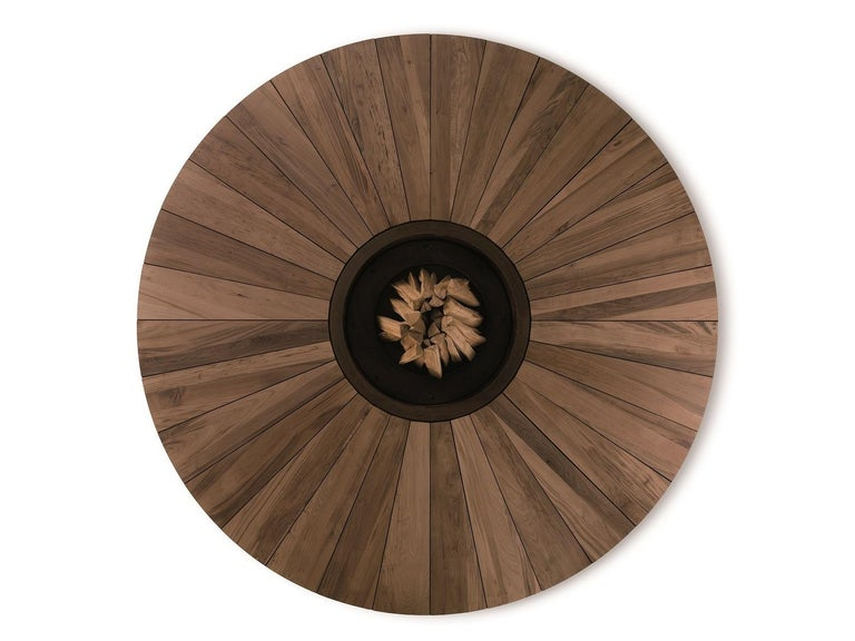 Artu Fire Pit designed by AK47 Design  A chestnut fire pit that combines traditional and updated components, the Artu by AK 47 Design does double duty as an outdoor sculpture and is ideal for open spaces, gardens, parks, terraces, hotel outdoor