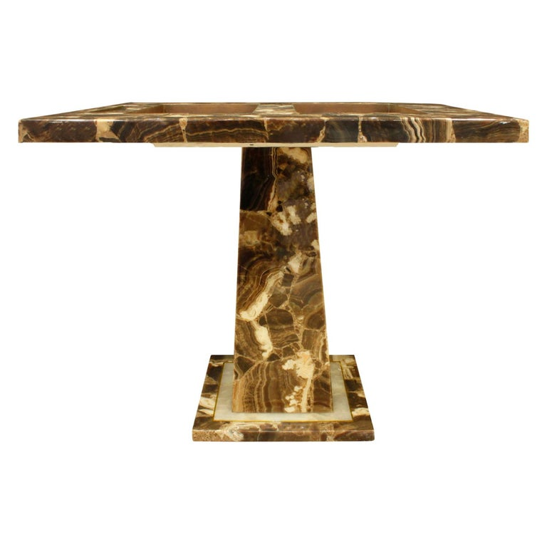 Artisan backgammon table in onyx set in resin with gilded detail around base by Arturo Pani for Muller's of Mexico, 1960s. Comes with game pieces and cups. This table is very luxurious.