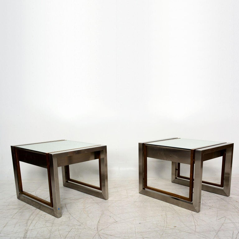 For your consideration a pair of modernist side tables designed by Arturo Pani. Stainless steel with brass frame. Mirror top (original). Features a pull-out drawer. Amazing design, very clean and simple. Unmarked. Dimensions: H 17.75 in. x W 23.75