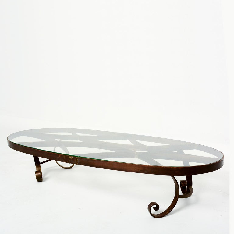 For your consideration: Midcentury Mexican modernism, a coffee table attributed in style to Arturo Pani. Constructed 100% of solid brass with a new glass top.  No labels or signature from maker present. Original vintage patina. Original vintage