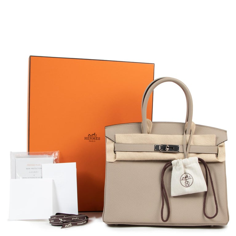 As new  Hermès Birkin 30Gris Tourterelle Togo GHW  The iconic Hermès Birkin bag is a must-have. This particular Birkin 30is an extremely rare and very sought after combination and it is sure to turn heads wherever you go!