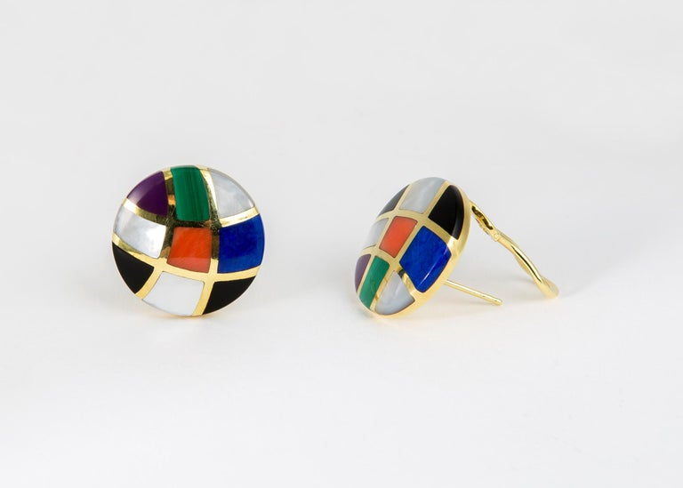 Asch Grossbardt combines coral, malachite, lapis, mother of pearl and black onyx in this bold round easy to wear earring. 7/8's of an inch in size.