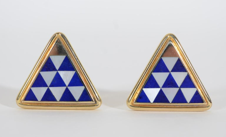 Beautifully made triangle shaped cufflinks by Asch Grossbardt. The interior triangles are made of Lapis lazuli; mother of pearl and gold. The backs are also inlaid with lapis as seen in last thumbnail photo. Measurements are 13/16