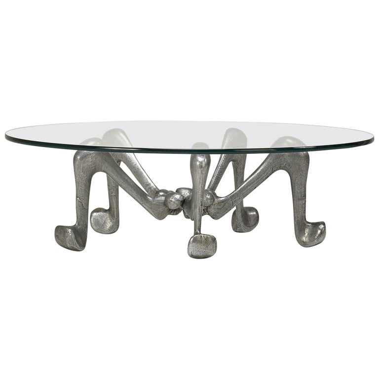Aschenputtel in Paradise Cocktail table. Chicago, 2018. Patinated Cast Aluminum-Magnesium and Glass. Provenance: Collection of the artist. Signed. Measurements; 36