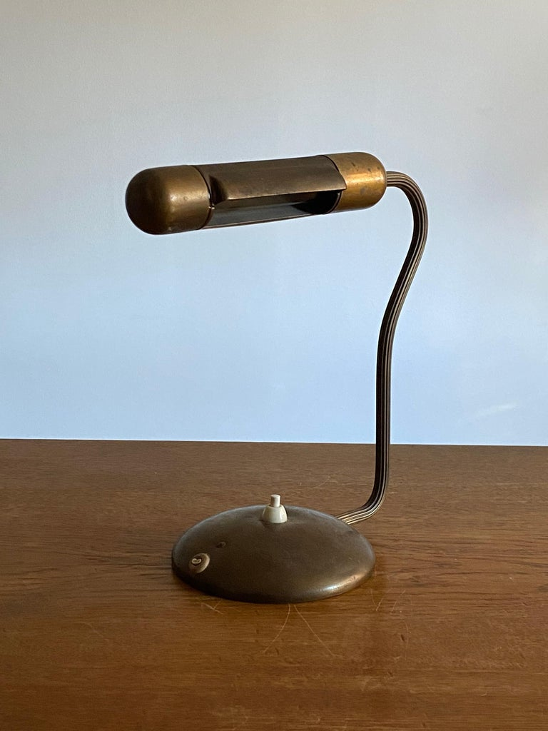 A rare and early functionalist desk lamp / table lamp. Produced by ASEA, Sweden, 1940s. In brass. Stamped.  Since being photographed the lamp has been rewired.  Other designers of the period include Hans Bergström, Paavo Tynell, Serge Mouille, and