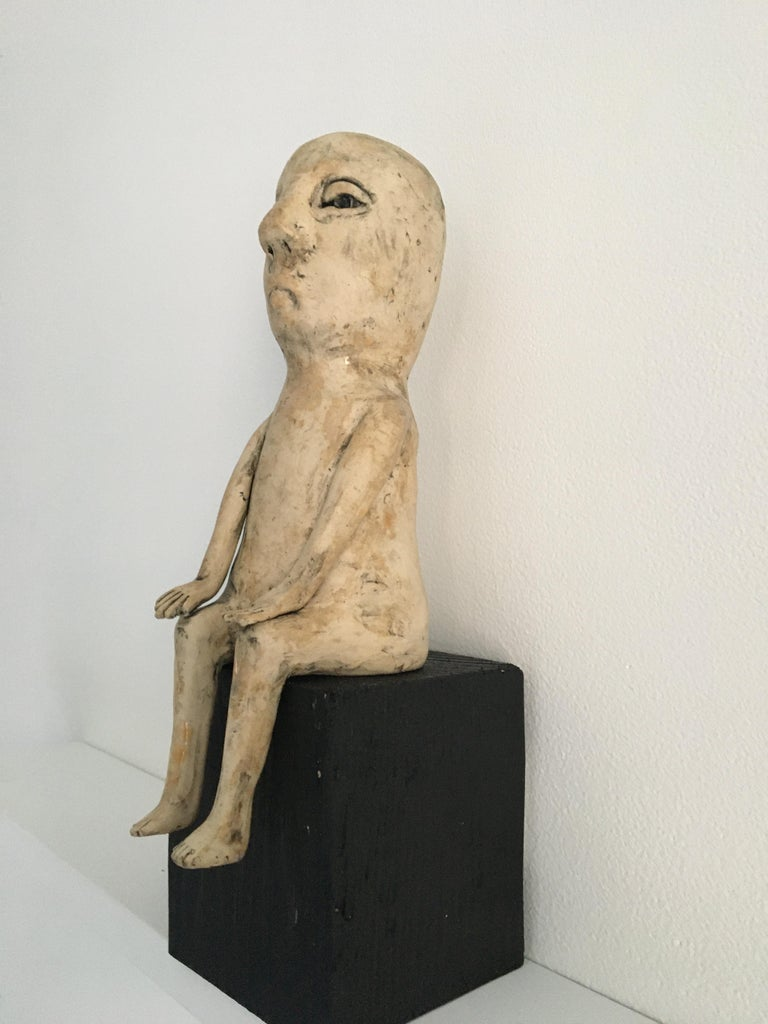 Ceramic figure on wood block: 'Enough of this' - Sculpture by Ashley Benton