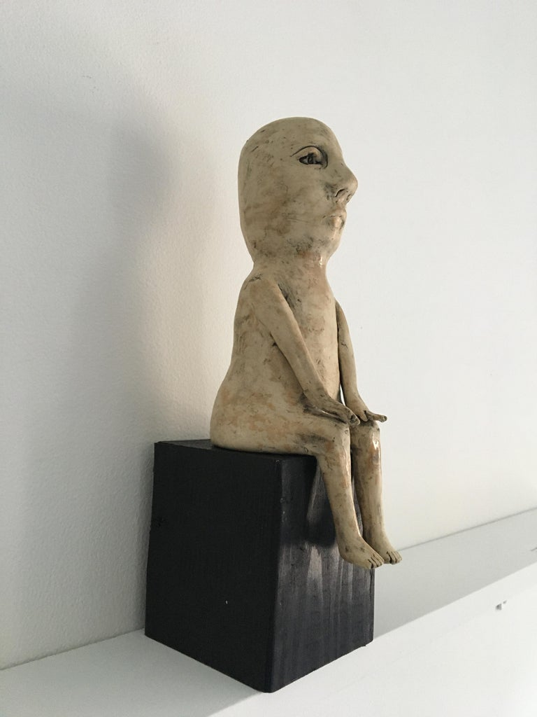 Ceramic figure on wood block: 'Enough of this' - Contemporary Sculpture by Ashley Benton