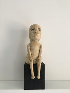 Ceramic figure on wood block: 'Enough of this'