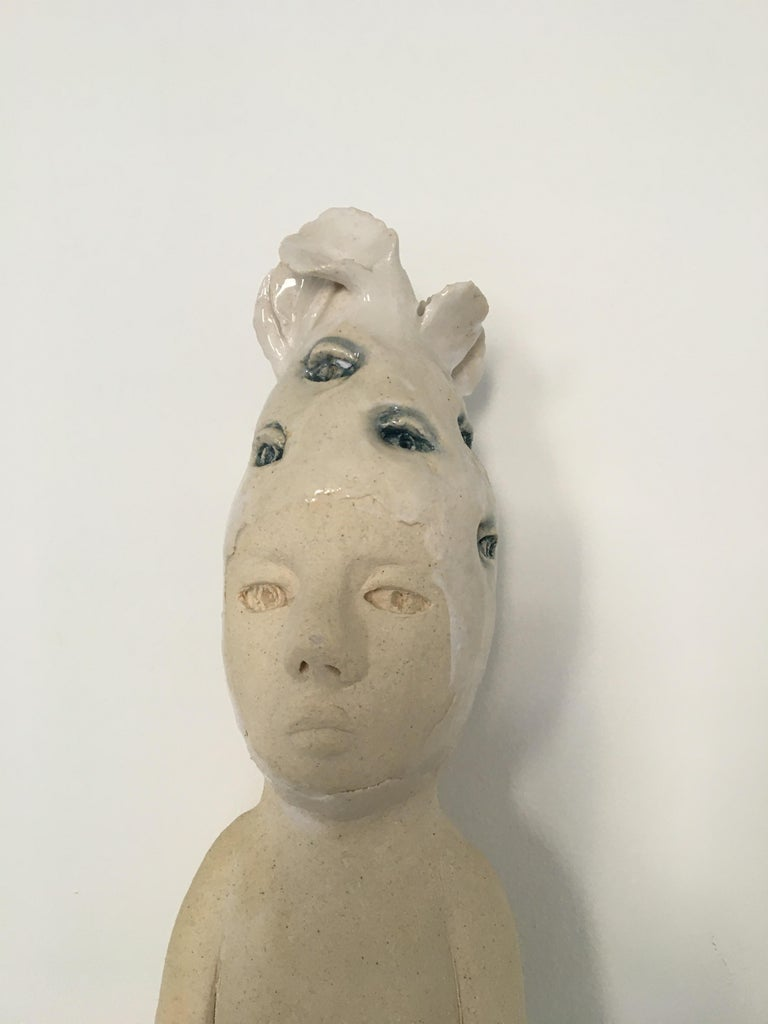 Ceramic wall hanging sculpture: 'Continue to seek' - Sculpture by Ashley Benton