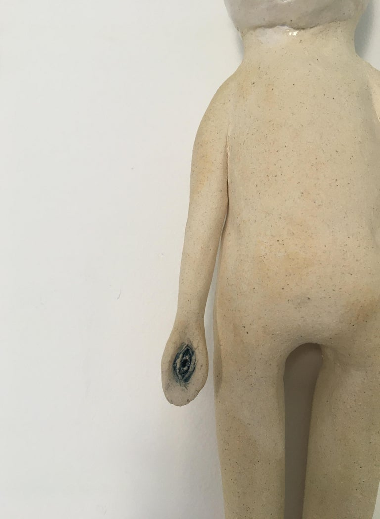 Ceramic wall hanging sculpture: 'Continue to seek' - Beige Figurative Sculpture by Ashley Benton