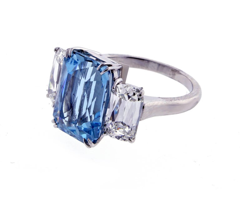 A Santa Maria aquamarine is paired with two of Ashoka cut diamonds creating a ring of unparalleled beauty.   The aquamarine weighs 6.85 carats. The two Ashoka G.I .A. certified diamonds weigh 1.38 and 1.44 carats and are H color and VS2, SI1