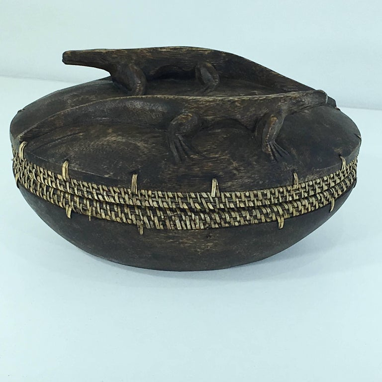 This box is from the Asian continent, made in the period, 1950-1960. We can see cane on the border, that gives an handmade authenticity and image to the item. It is in good condition, and the color is brown and kind of yellow. The sculpted animals