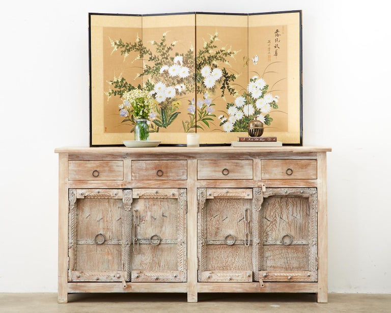 Japanese style Asian Showa period four-panel screen of autumn flowers in bloom. The colorful screen features butterflies, chrysanthemums, Chinese bellflowers, and brush clover. Signed by artist with four seals. Set in a lacquered frame with a bright