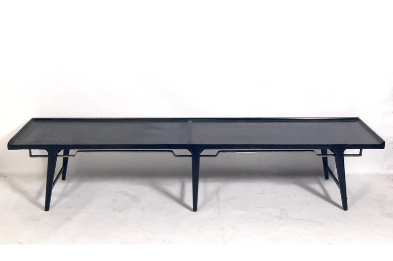 Asian influenced Mid-Century Modern bench, probably American, circa 1950s. This bench is currently being refinished and can be completed in your choice of color. The price noted includes refinishing in your choice of color. If you would like us to
