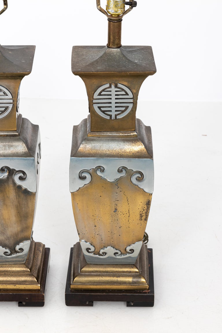 All original James Mont Asian style mixed metal lamps with original harps and finials. As found condition with lots of patina, some wear. James Mont style mixed metal lamps with original finials. As found condition with patina. Nicely made, heavy.