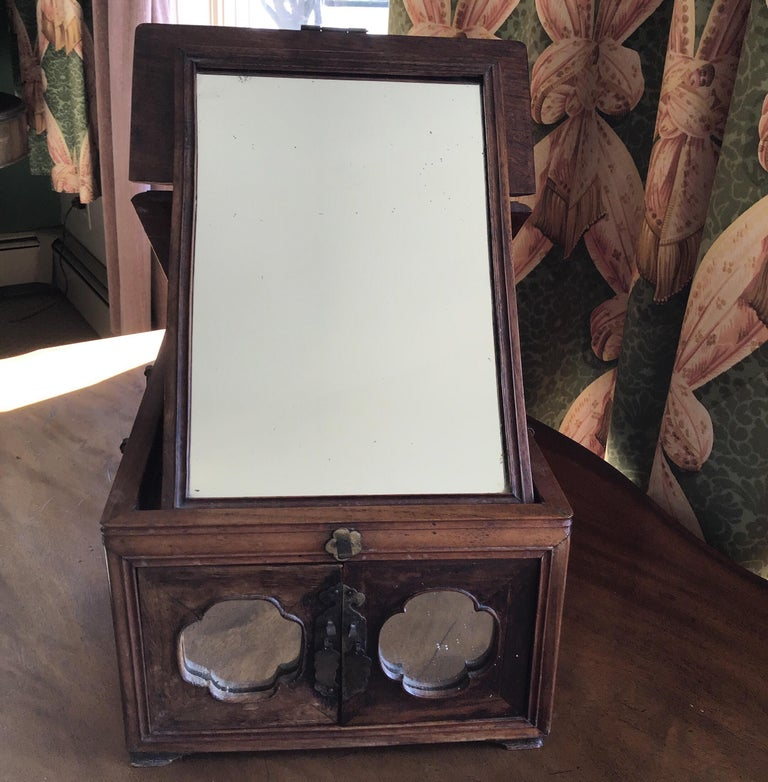 Mirrored traveling makeup /jewelry case with silvered butterfly hinges.
