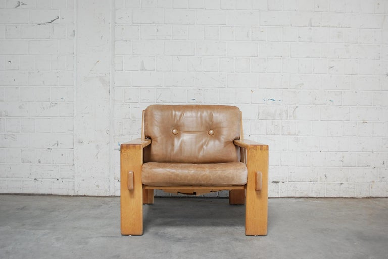 Leather armchair in solid oak frame with brown caramel cushions by Esko Pajamies for Finland manufacture Asko. Model Bonanza. From 1960.
