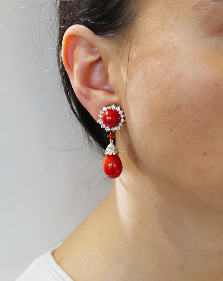 Beautiful dangle earrings created by Asprey in the 1980s. Feminine, stylish and wearable, the earrings are a great addition to your jewelry collection.  Made of 18 karat yellow gold, the earrings feature gorgeous deep red color Mediterranean coral